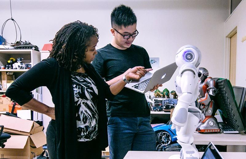 Dr. Ayanna Howard and graduate student, Jin Xu, setting up the NAO robot.